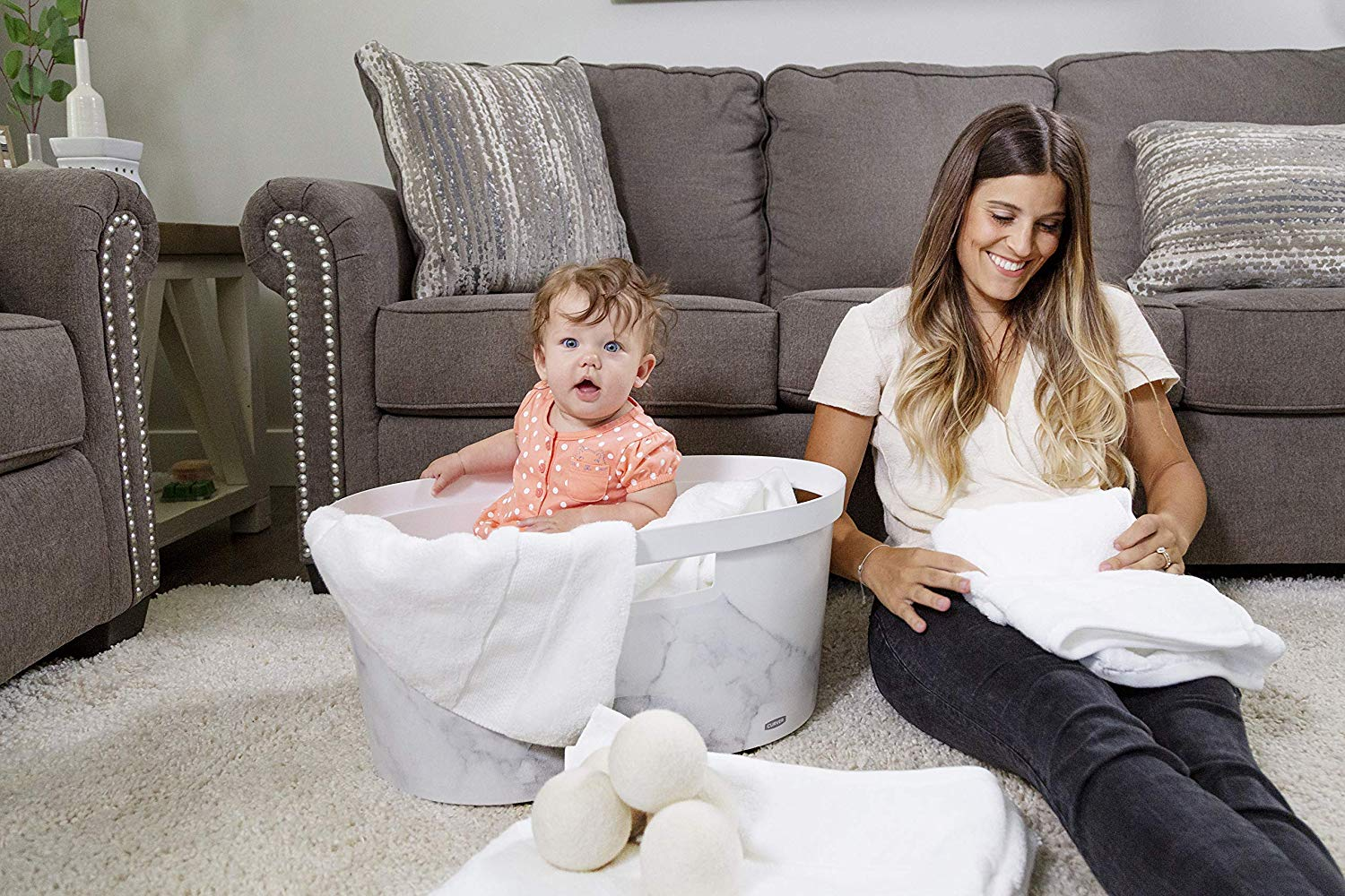 baby and mom doing laundry