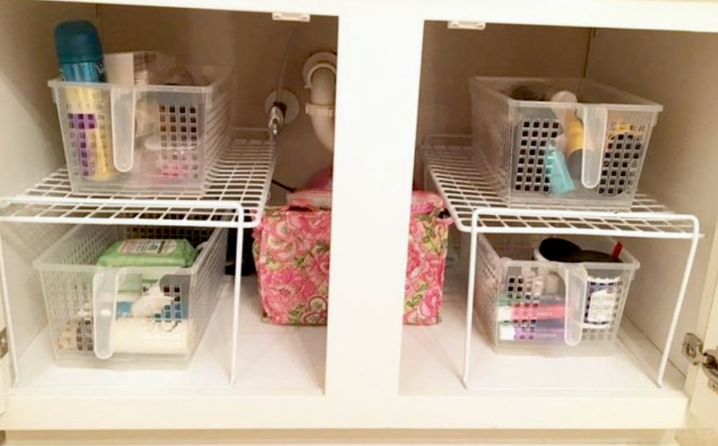 bathroom sink with clear pantry baskets under sink