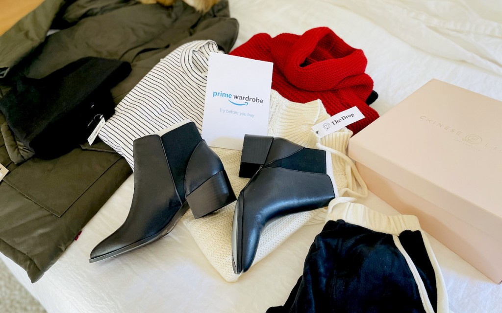 amazon personal shopper clothes and booties laying on bed