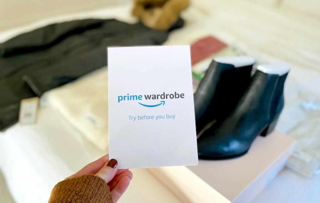 hand holding a prime wardrobe pamphlet