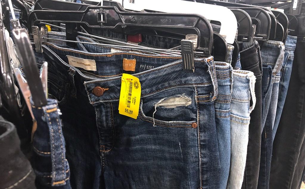 designer pilcro jeans on rack at thrift store