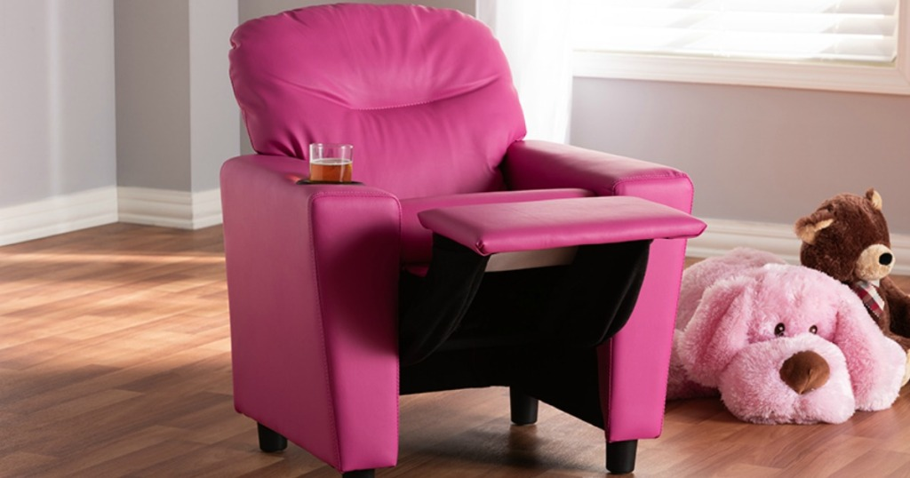 pink leather kids recliner chair with juice in the cupholder in child's bedroom