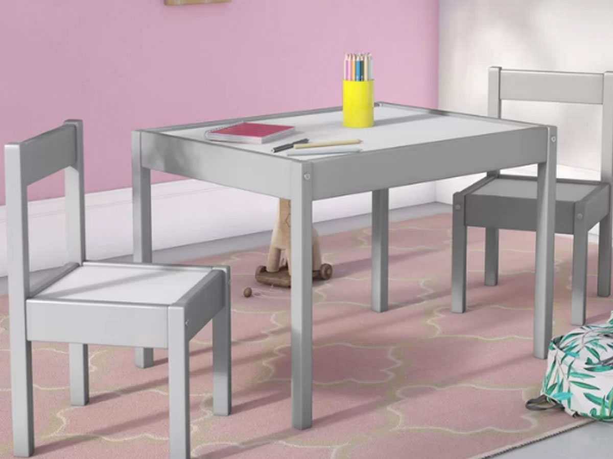 table and chairs in pink room