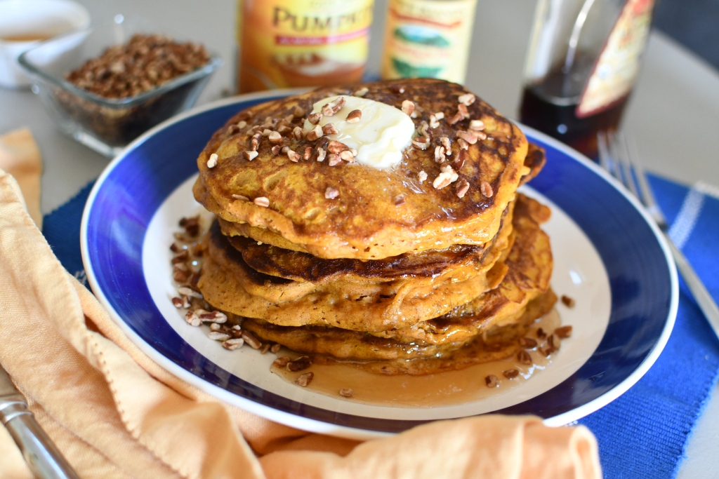 plate of pumpkin pancakes with pecans