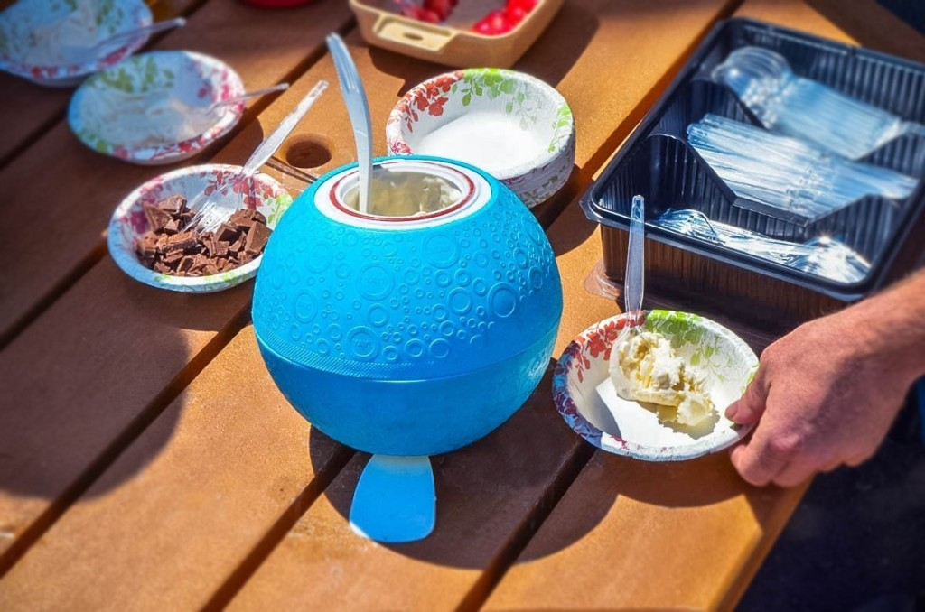 round blue ice cream maker on picnic table