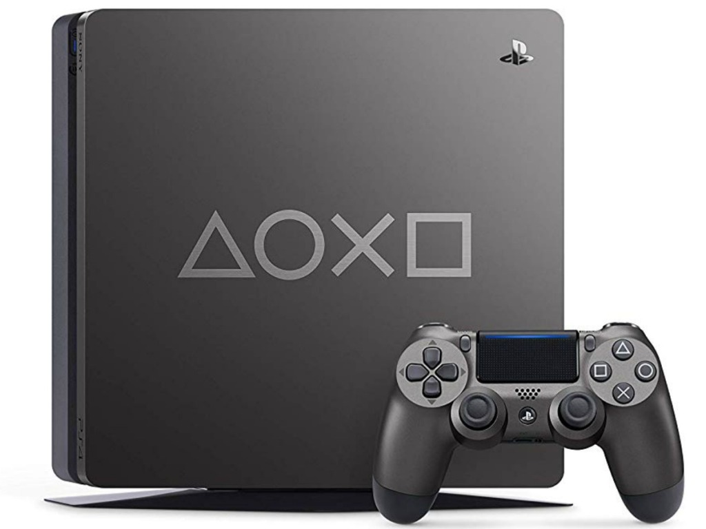 playstation console with controller on white background