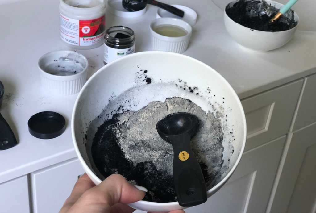 bowl of gray and black powder in bowl