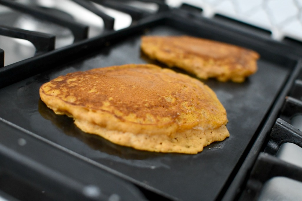 pumpkin pancakes on the griddle