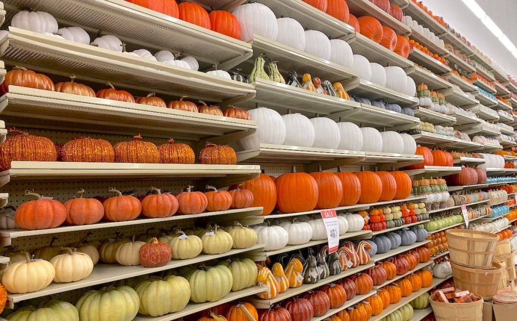 hobby lobby store aisle stocked with tons of different colored pumpkins