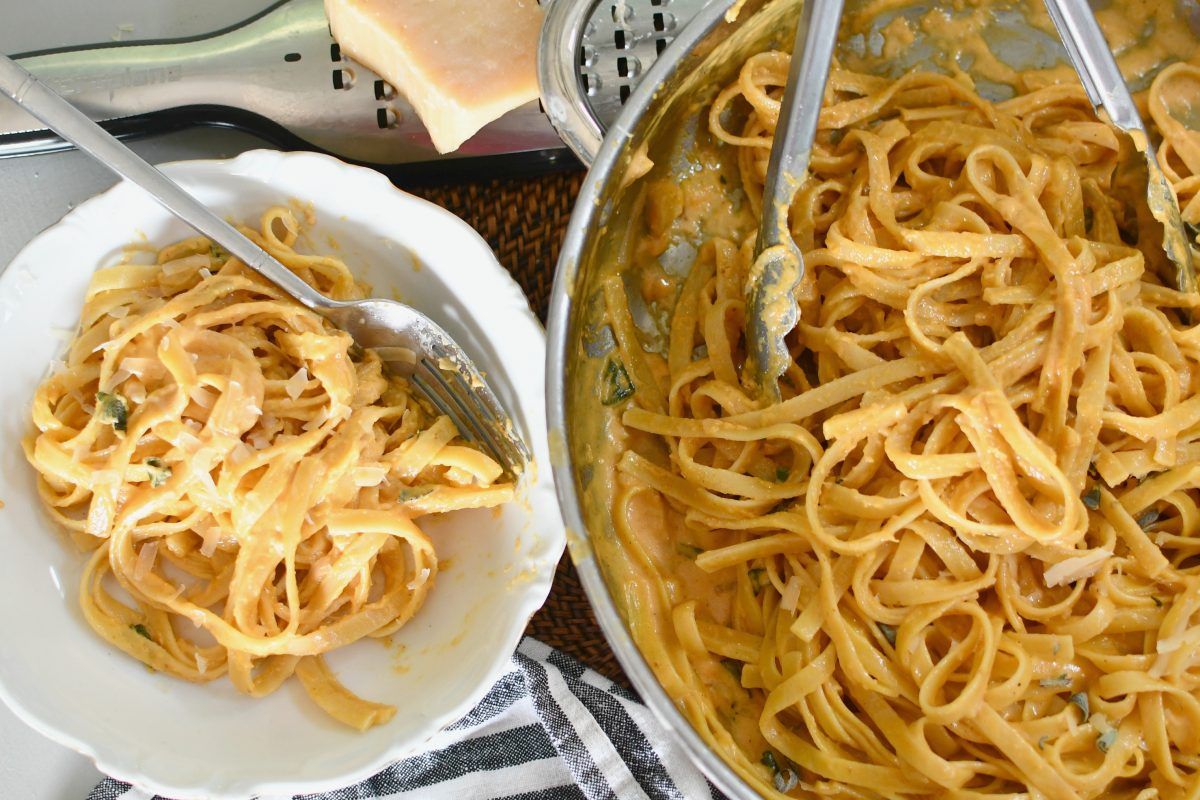 skillet and plate of pumpkin alfredo