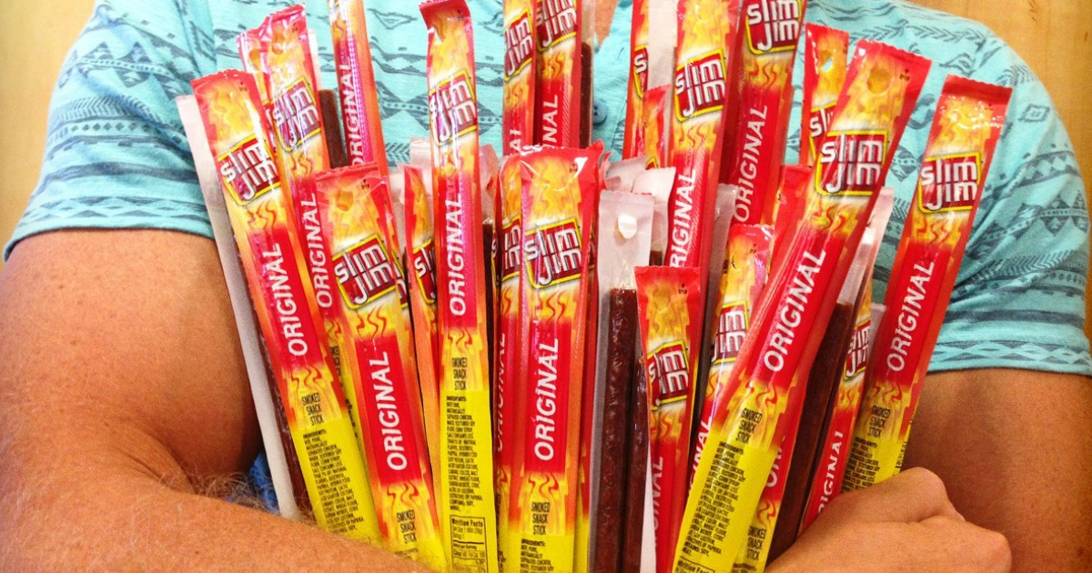 man holding lots of slim jims