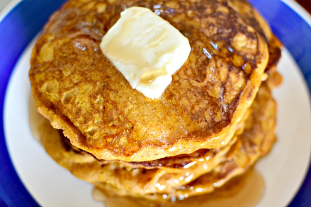 stack of pumpkin pancakes with butter on top