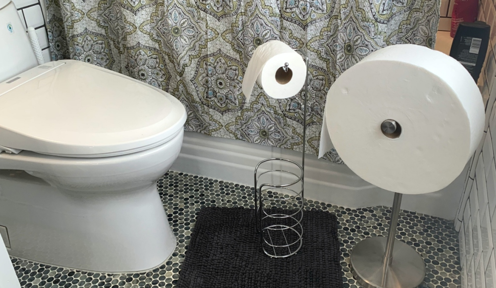 standard toilet paper roll next to huge Charmin roll