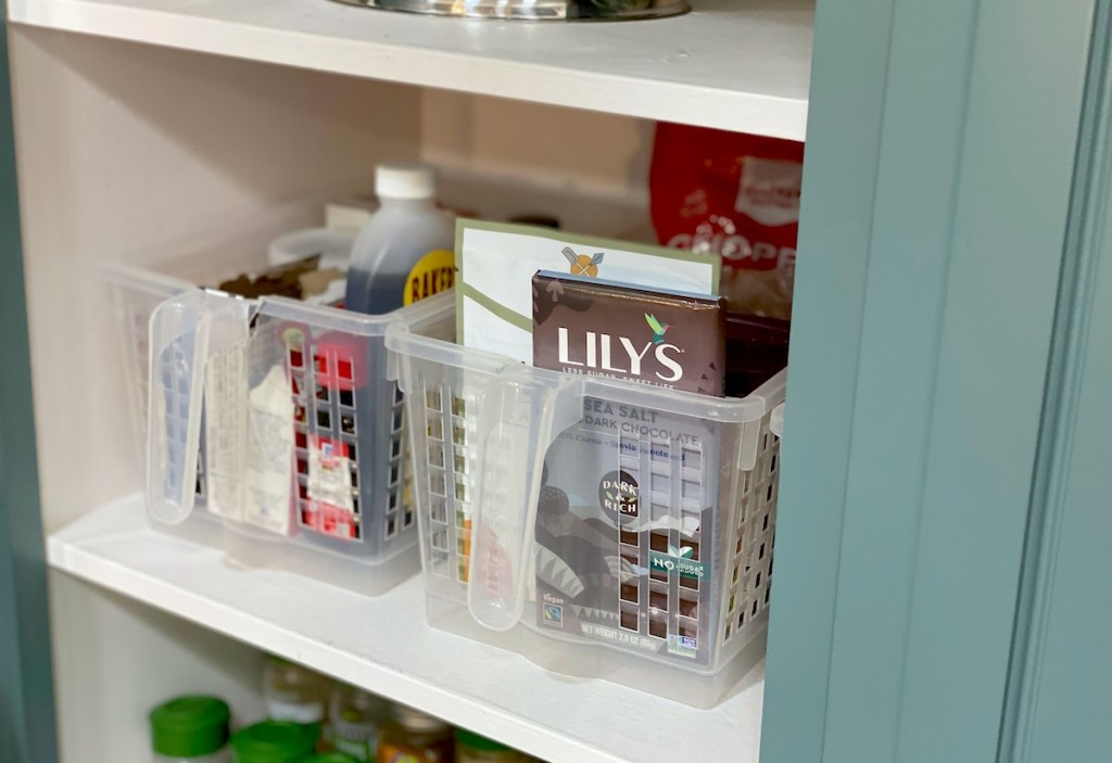 clear containers on pantry shelf with food