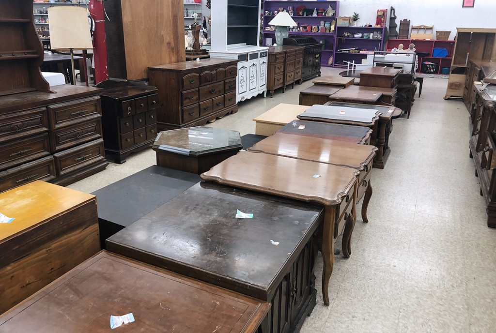 end tables, coffee tables, and dressers at thrift store