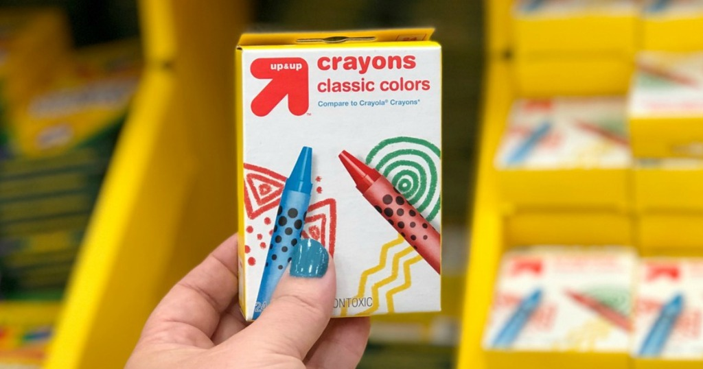 hand holding up & up crayons at target