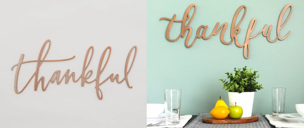 thankful script wood metal sign on gray and blue wall