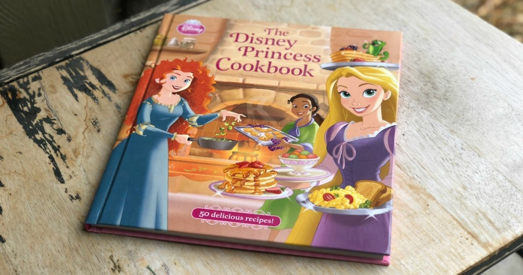 hardcover copy of the Disney Princess Cookbook on a table