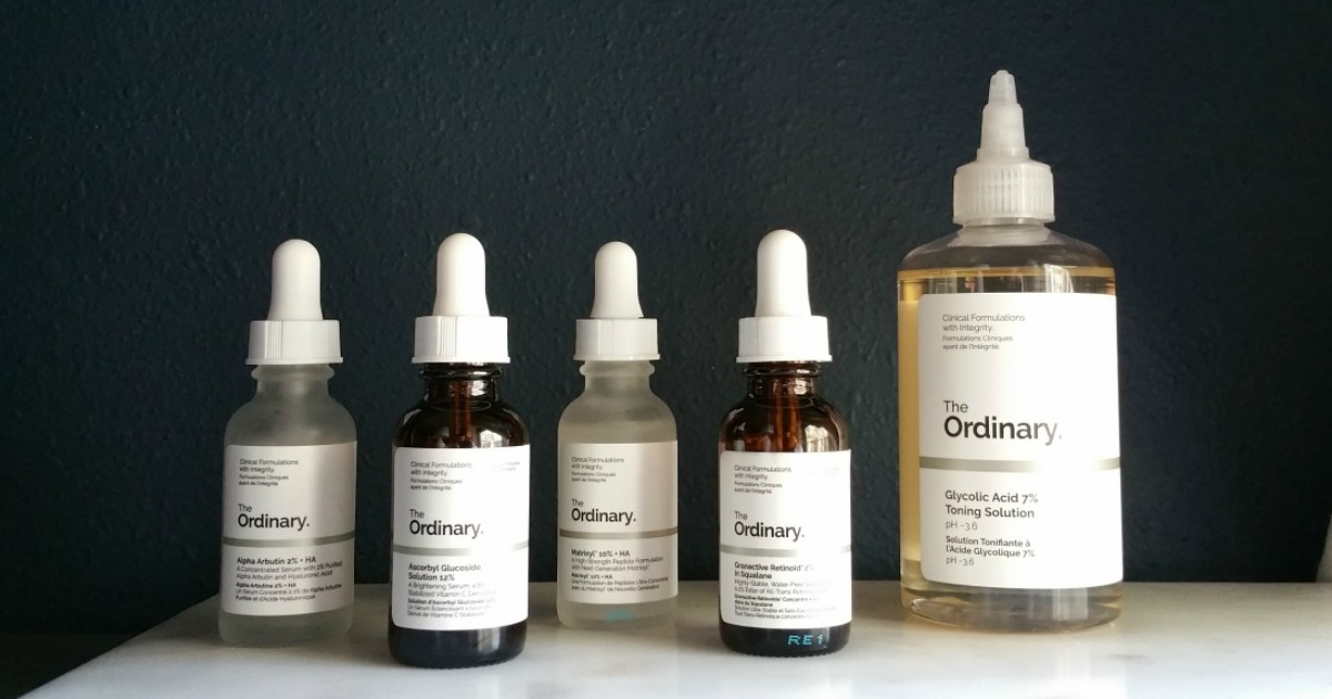 row of clear and brown amber dropper bottles with the ordinary labels on front best make up brands cheap vs luxury