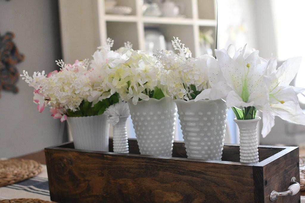 milk glass vases in centerpiece