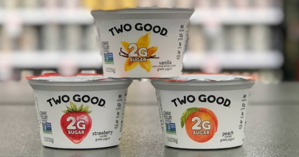 three containers of Two Good yogurt on store table