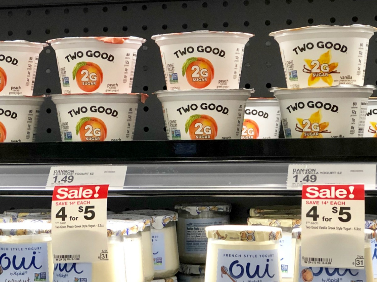store shelf showing price tags and Two Good and Oui yogurt cups