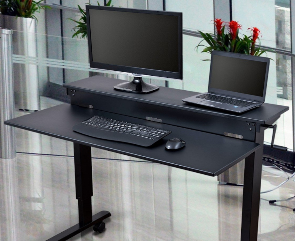 black standing desk with monitor and laptop