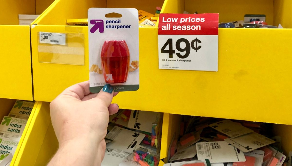 holding up pencil sharpener next to price tag