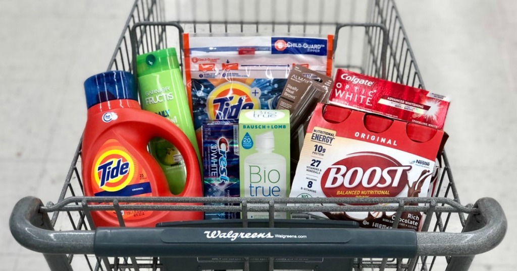 tide laundry detergent, garnier shampoo, crest and colgate toothpaste, biotrue contact lens solution and boost nutritional shakes in shopping cart at walgreens
