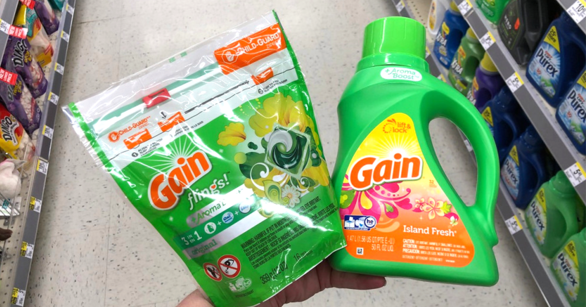 gain flings and liquid detergent hand holding