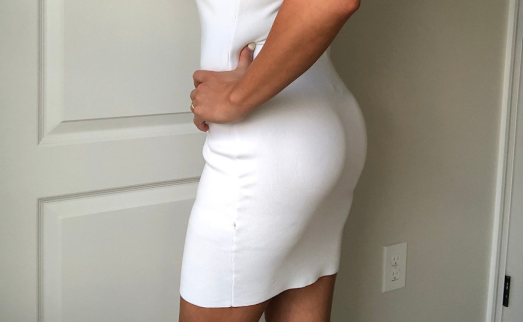woman wearing white dress with butt enhancer