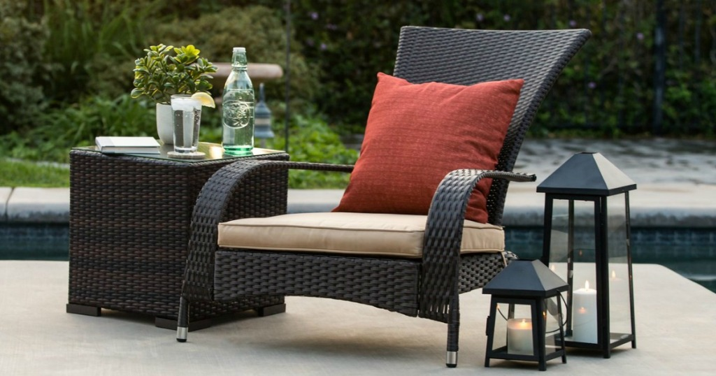 wicker chair outdoors with pool in the background