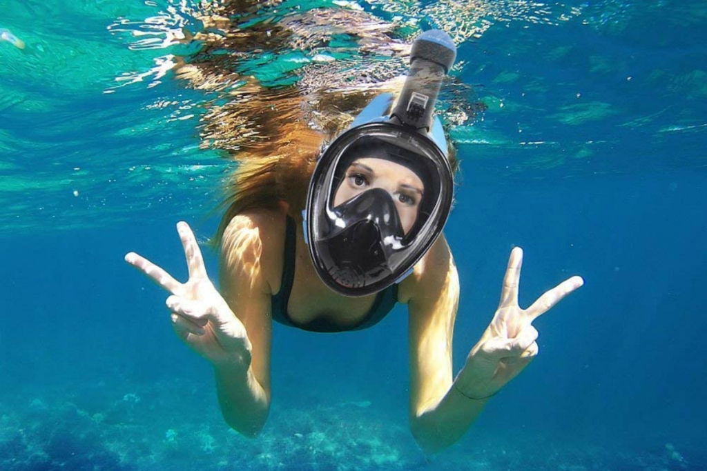 woman underwater with snorkeling face mask