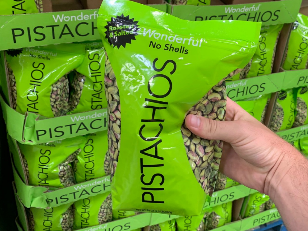 hand holding bag of pistachios in store