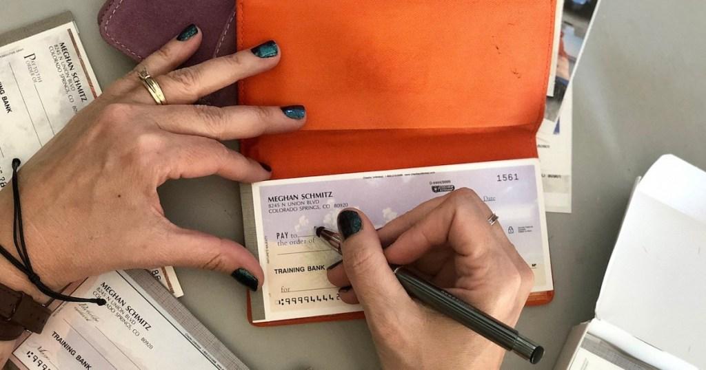 hand writing on blank checkbook