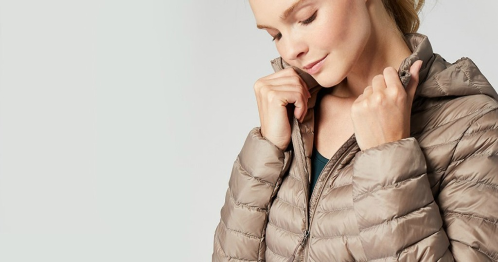 Woman wearing taupe colored down jacket