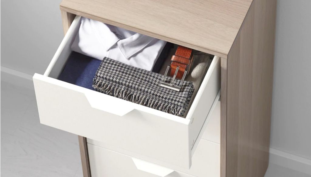clothes and accessories in top drawer of IKEA dresser