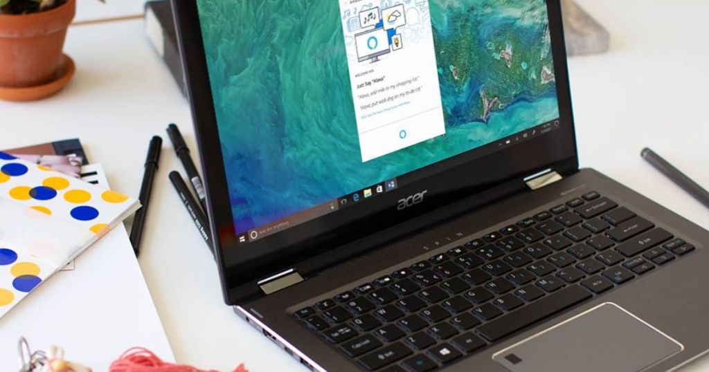 Acer Spin Laptop on table with writing utensils