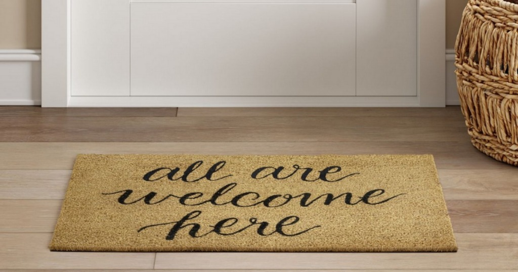 All Are Welcome Here Tufted Doormat on front porch