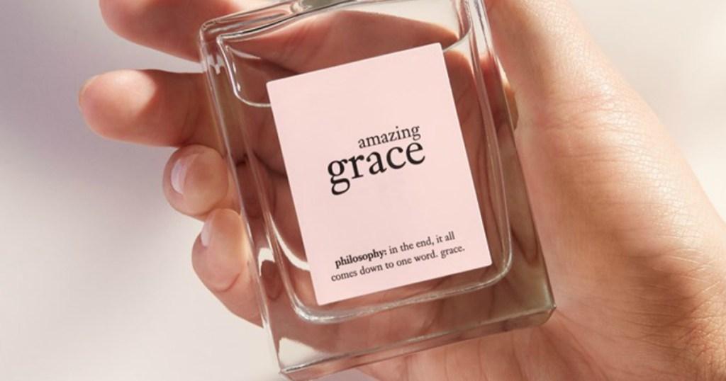 hand holding Amazing Grace Perfume