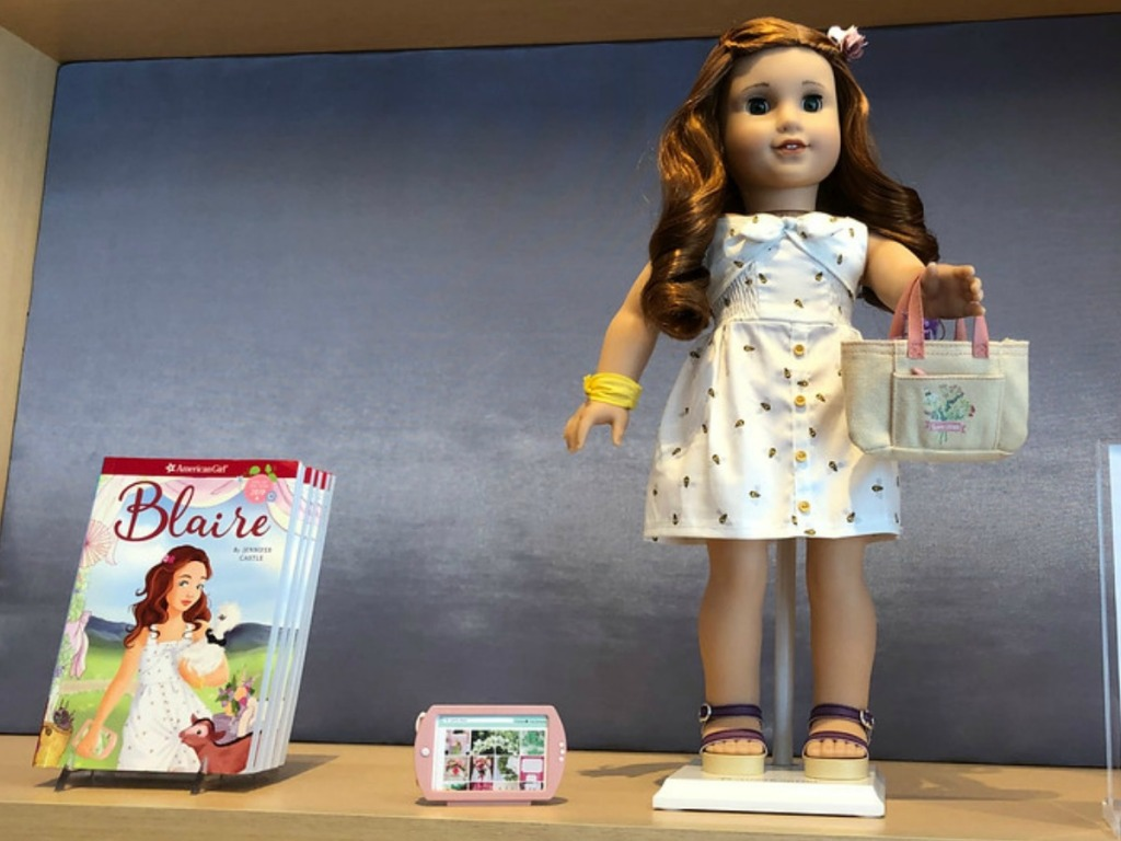 American Girl Doll and a book in American Girl Store