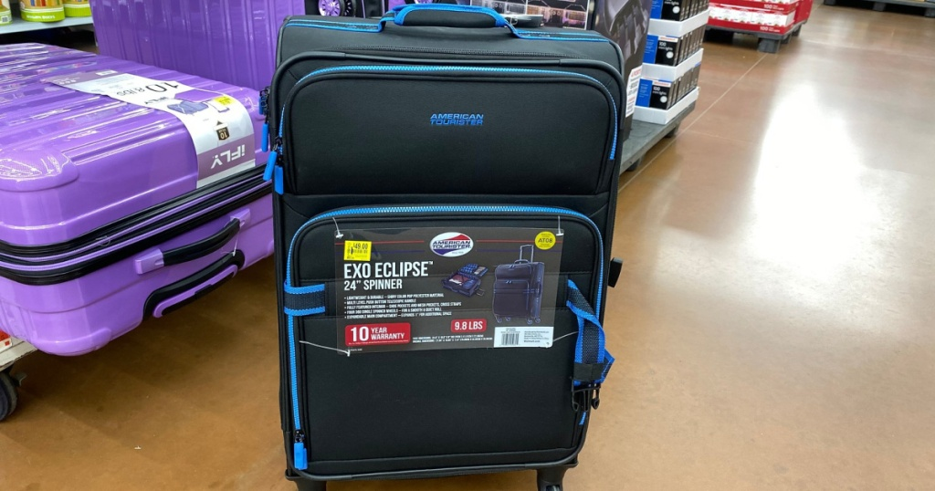 american tourister luggage on floor at walmart