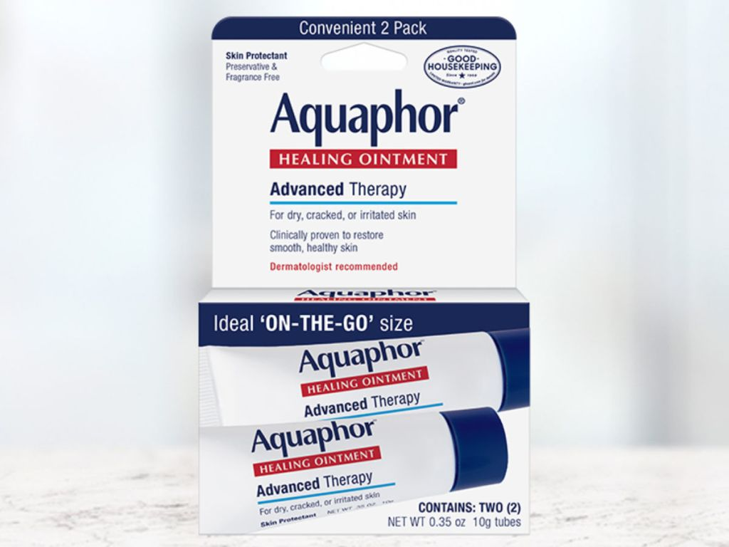 Aquaphor Healing Ointment On The Go on marble background
