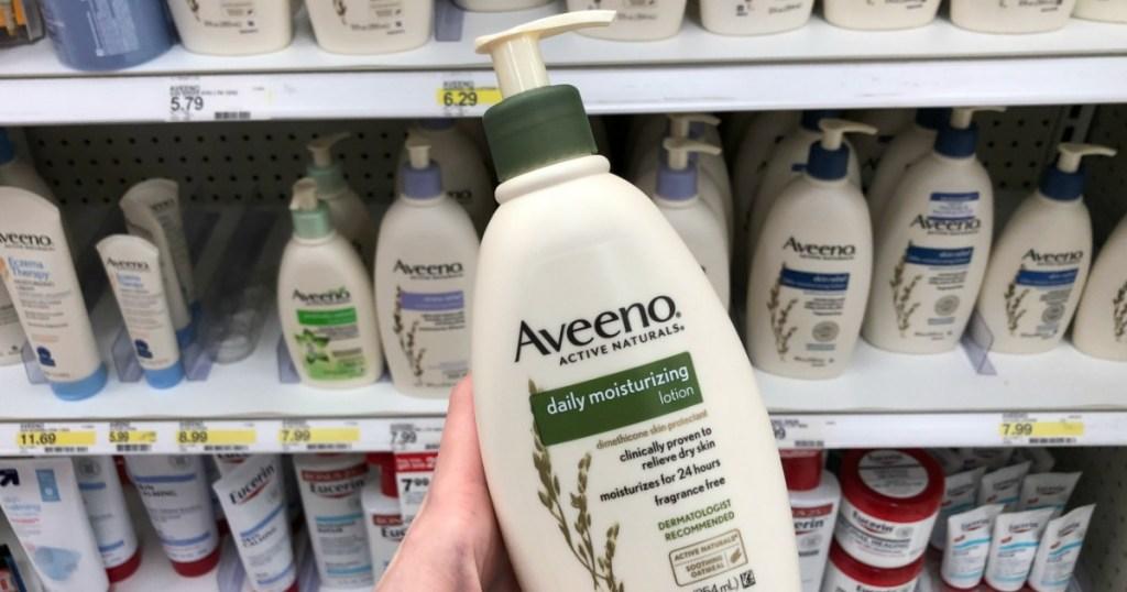 hand holding Aveeno Lotion at Target