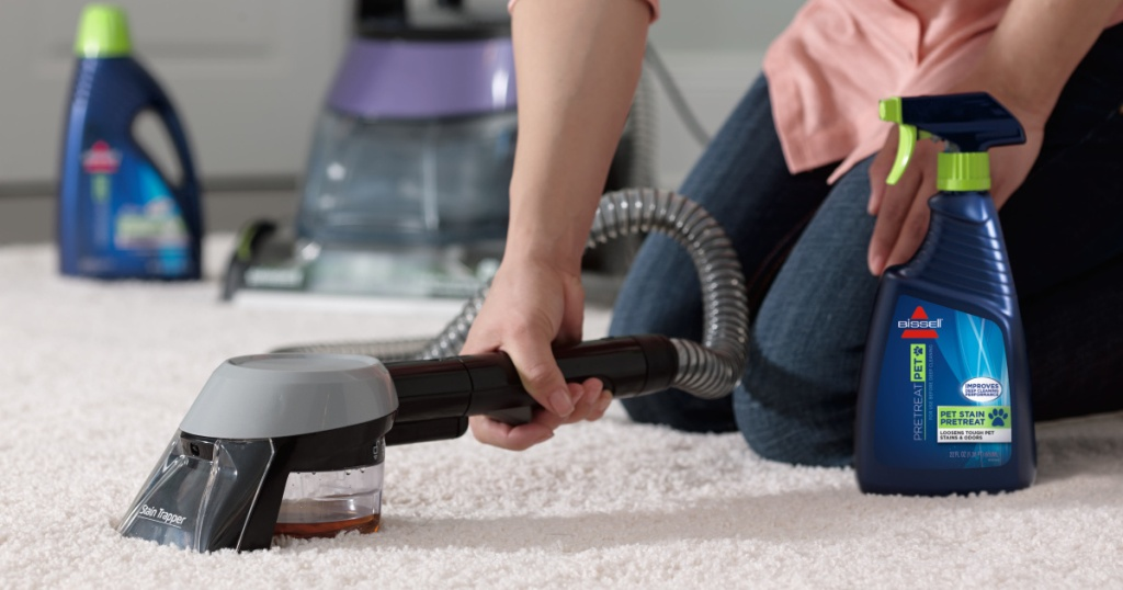 woman cleaning carpet with bissell depclean deluxe