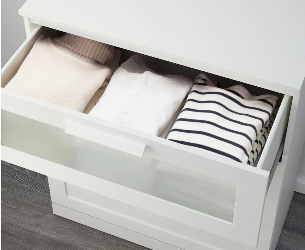 clothes in top drawer of dresser