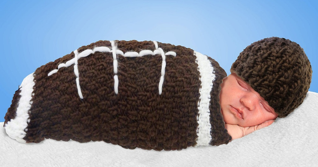 newborn wearing crochet football costume