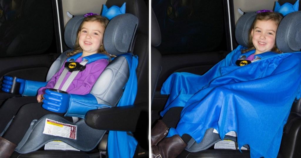 little girl sitting in a Batman Car seat