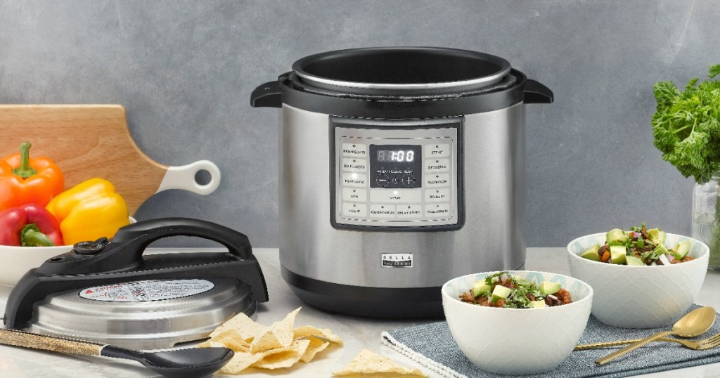 Bella Multicooker on table with bowls of food by it