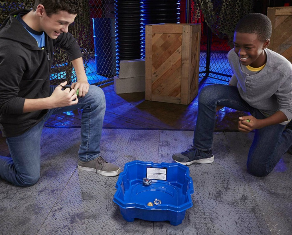 boys playing with Beyblade Burst Turbo Slingshock Beystadium